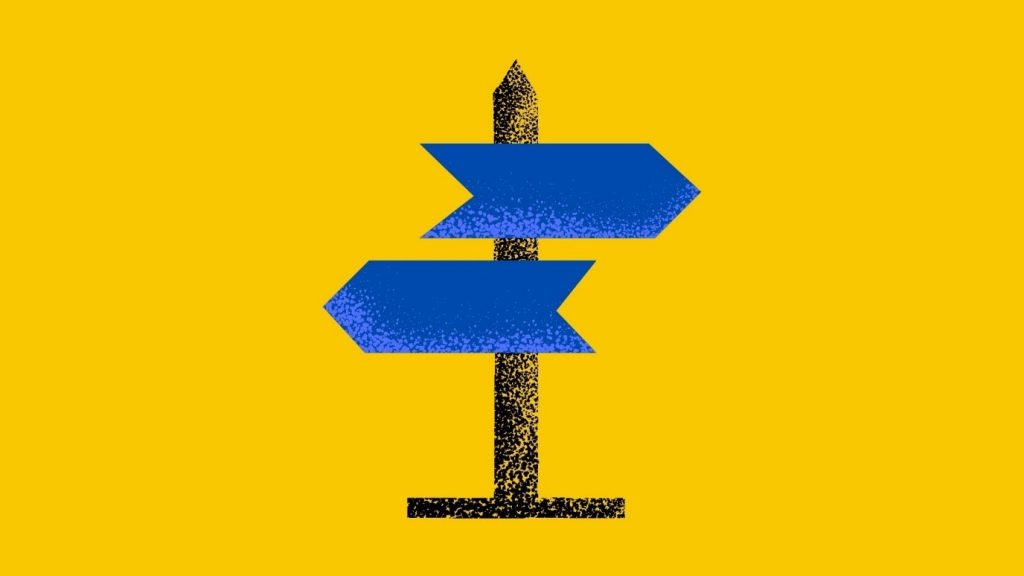 A blue wayfinding sign on a yellow background.