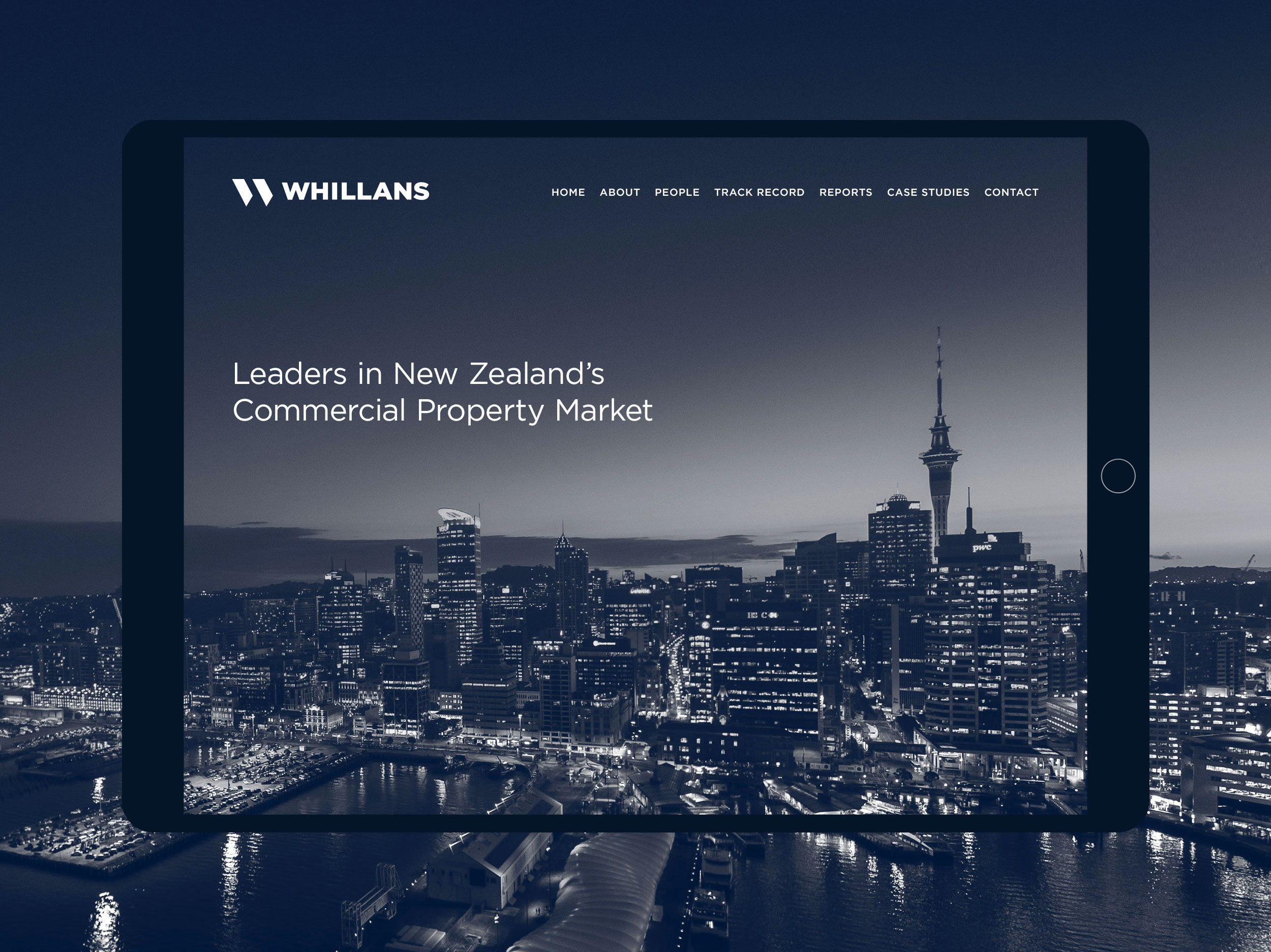 Mobile friendly website for Whillans displayed on a tablet